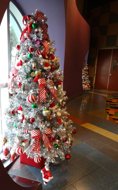 Pop Century Resort - our favorite! the sliver Christmas trees in the food court!
