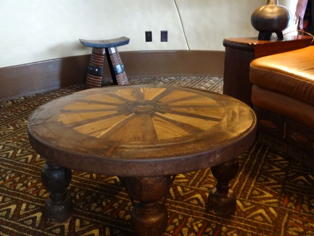 This item is not only a table. A king in Africa gave this wagonwheel to Disney as a gift - the Imagineers turned into a table for the King's Room (Royal Room)
