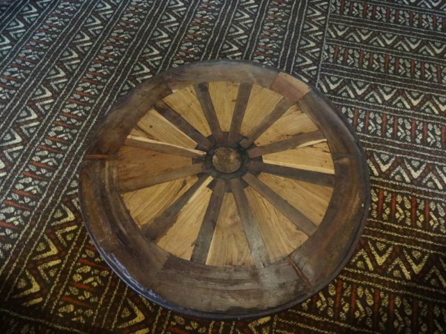 The wooden wagon wheel created a beautiful table