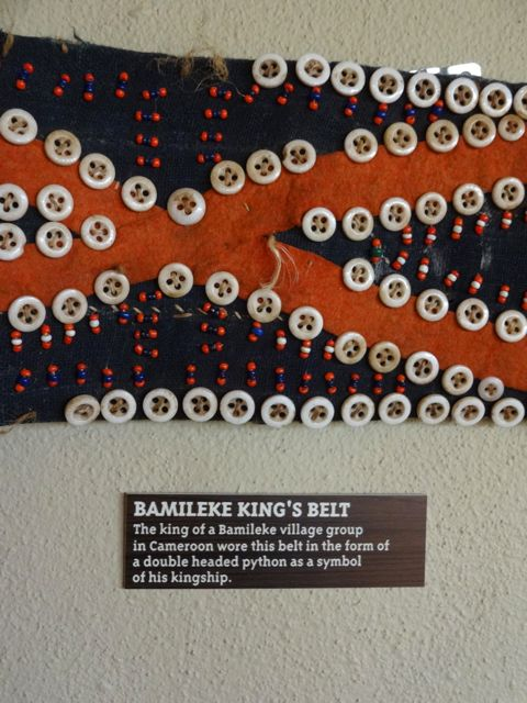 King's Belt - simple strips of fabric with buttons and beads, yet a symbol of power