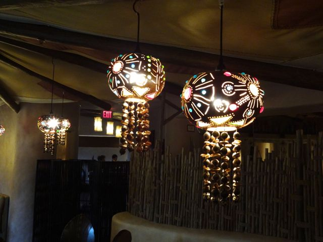 These lights (in the small dining area to the right) are made of hollowed out and carved gourds, decorated with bits of colored glass & seeds & nuts