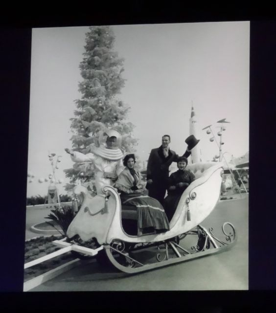 Just a cool photo - Dickensian Cast Members and Space Age Cast Members in the same winter sleigh with a Christmas tree in the background