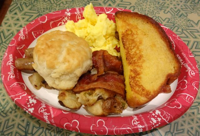 Breakfast! Scrambled eggs, sausage, bacon, potatoes, french toast, and biscuit