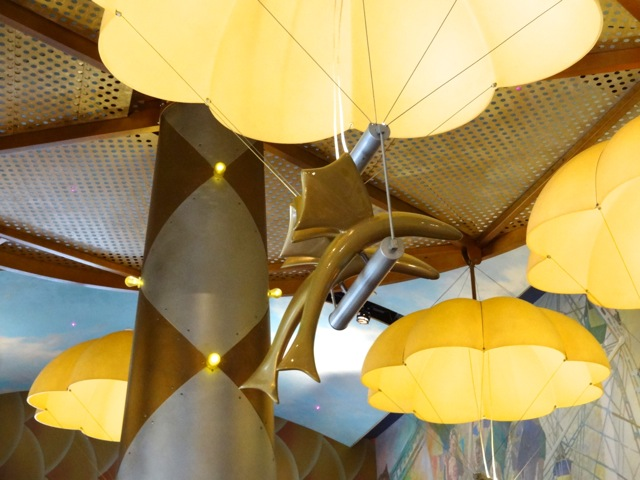 Light fixtures are themed as flying fish with parachutes