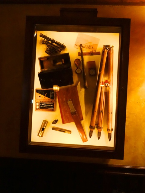 There are a number of display cases on the wall at Territory Lounge, this one contains Surveying Tools. There are others that contain artifacts dedicated to Teddy Roosevelt (because he revamped the National Parks), to photography during the late 1800's, and to the trappers who caught food and furs.