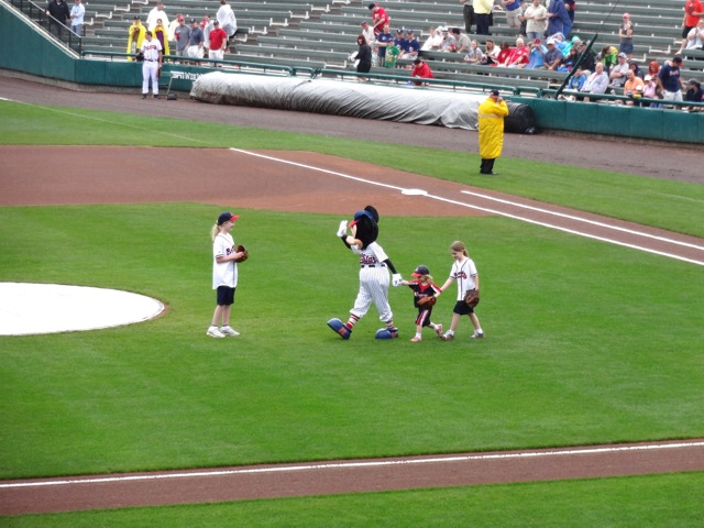 Mickey Mouse takes the field with some kids...
