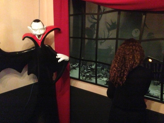 "... there's a ""window"" next to the vampire (a glassed in area with a diorama..."