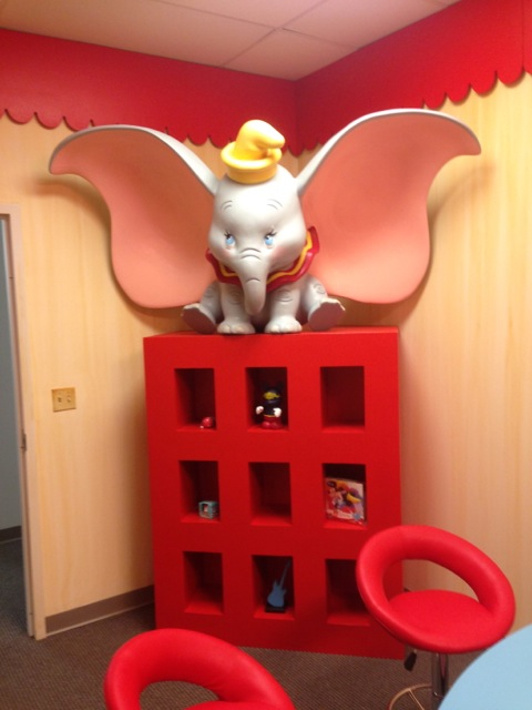 ...Dumbo preparing to fly atop her storage unit...