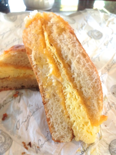 close up of Egg & Cheddar breakfast sandwich