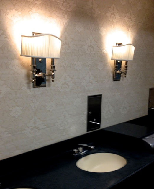 Sink area. The ladies room was all soft creams while this shows that the mens room is done in more masculine colors.