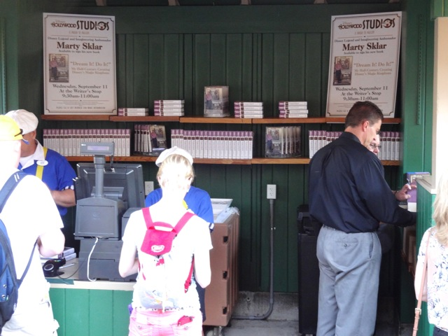 You purchased your book(s) [limit two per guest] at the New York News Stand. There were two cash registers and loads of suited-Cast Members (i.e. managers) around to help.