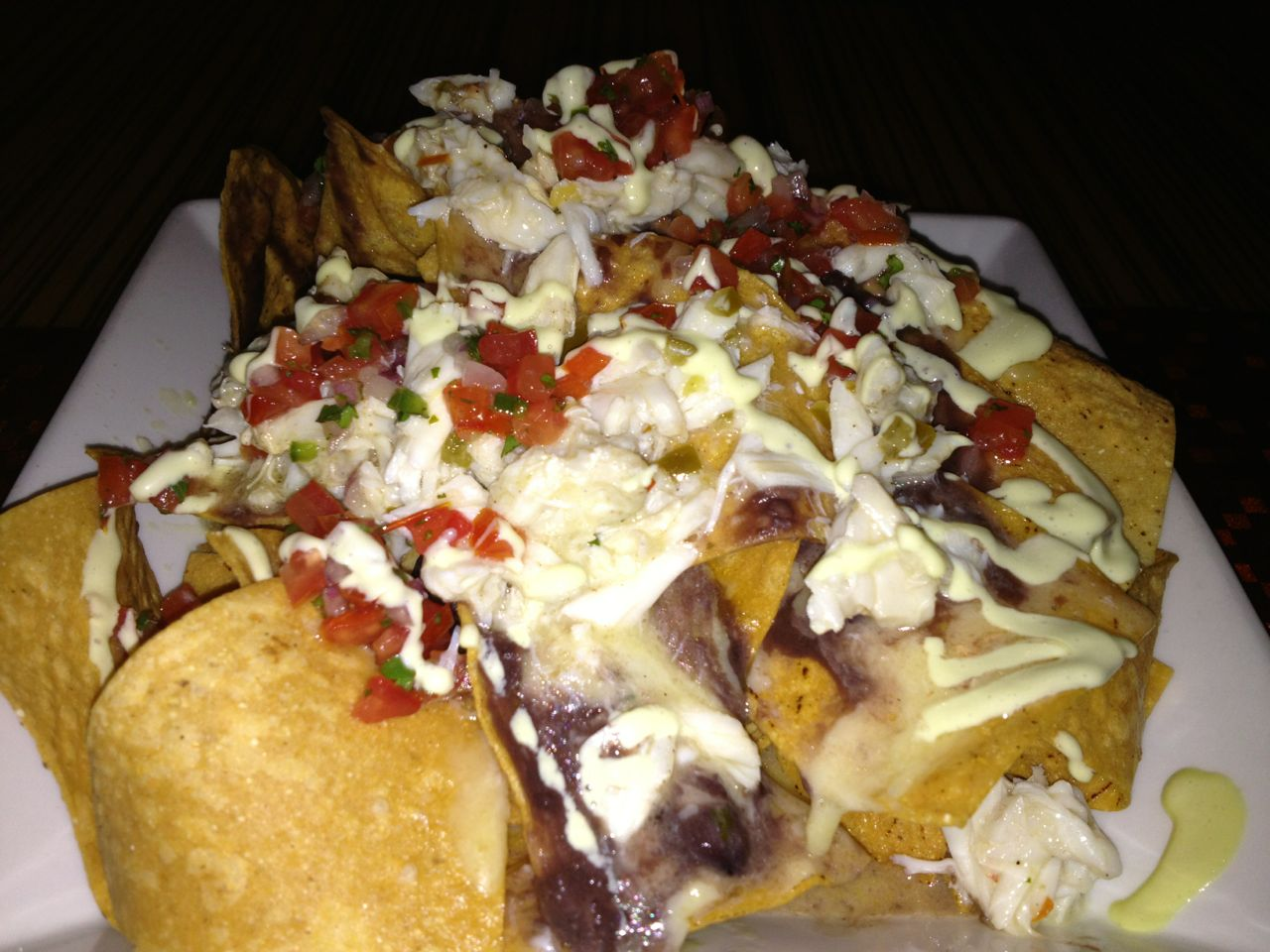 Crab nachos from bluezoo... very happy they're staying (we heard there'd be a rampage if they left :)) - sorry for quality of photo, originally for tweeting not posting