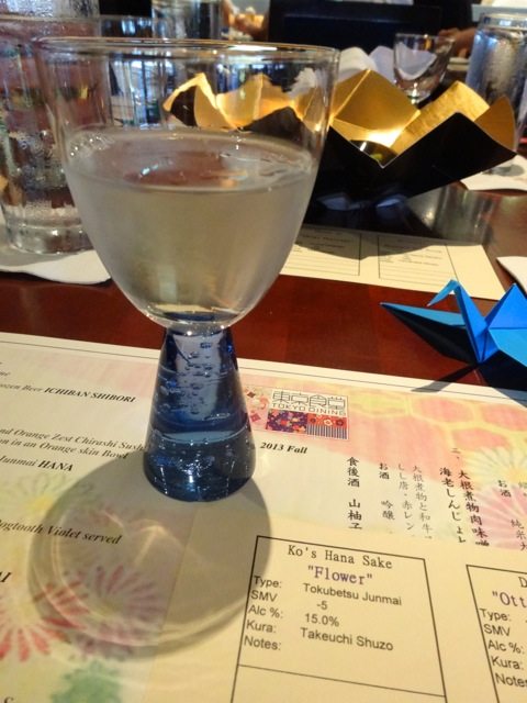"our first sake... Ko's Hana Sake ""Flower"" served in a ""horse riding glass"" (apparently nobles wanted to be able to drink their sake while on horseback)"