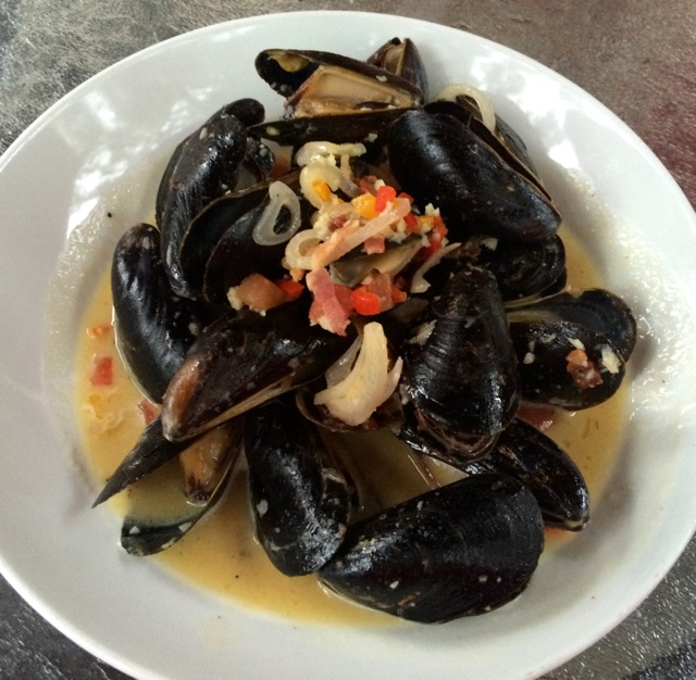Prince Edward Island Mussels - bacon, white wine & butter sauce, onions, finely diced peppers