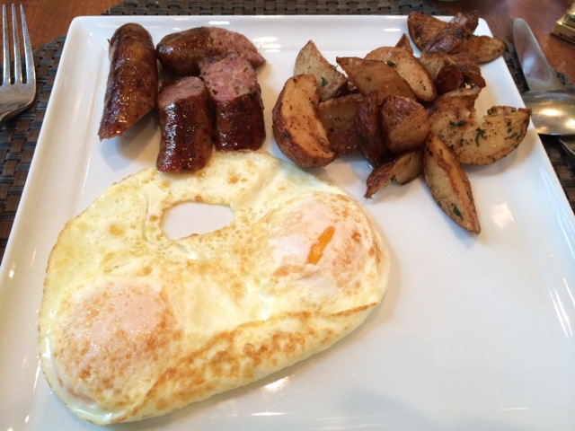 NIck ordered a traditional breakfast - eggs over medium, Cib's smoked turkey sausage, potatoes, and an English muffin