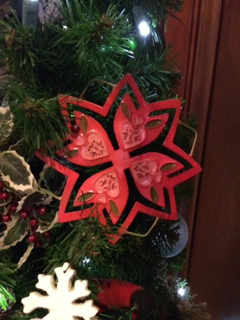 a cut out snowflake (very similar to snowflake motifs in knitting)